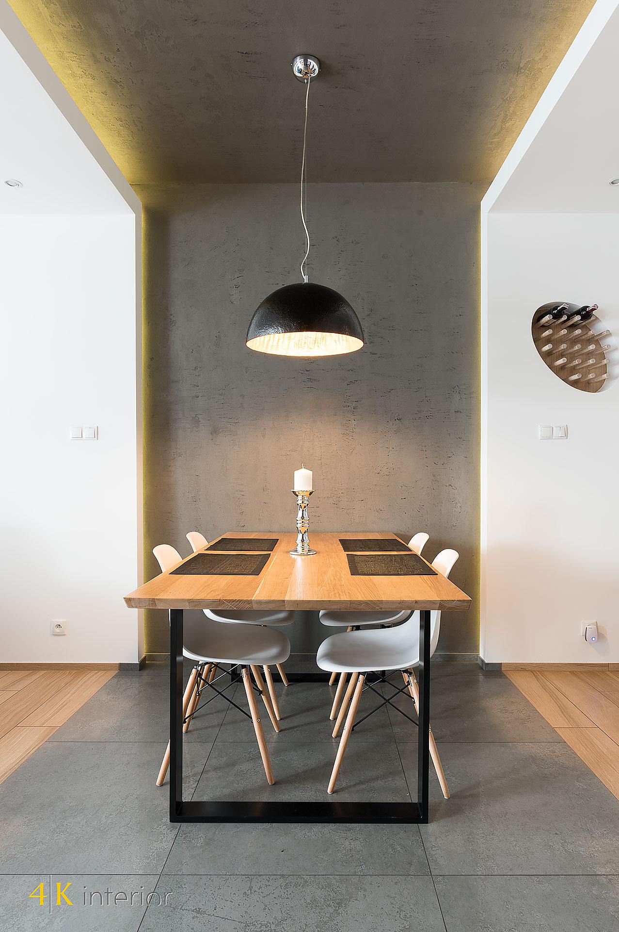 NOWOCZESNE-WNĘTRA-DOMU-Z-MOTYWEM-ELIPSY-05 beton dekoracyjny w jadalni oryginalny ciężki stół