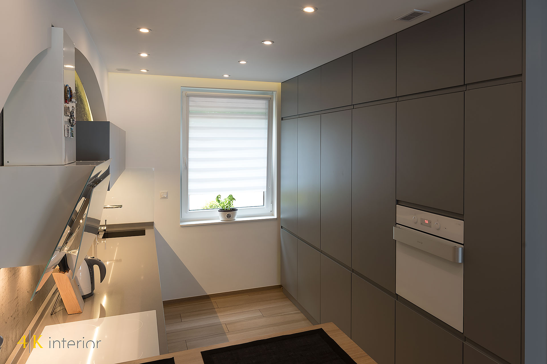 NOWOCZESNE-WNĘTRA-DOMU-Z-MOTYWEM-ELIPSY-09 nowoczesna szafa w kuchni